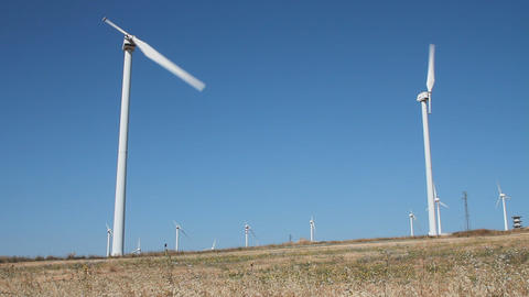 Field of single blade wind turbines Stock Video Footage
