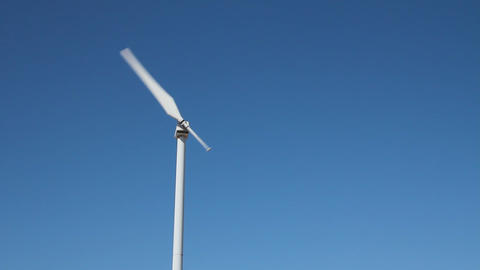 Single blade wind turbine in function and plants Footage