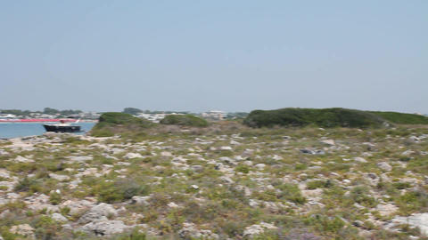 Rocky island and sea Stock Video Footage
