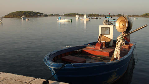 Docked fishing boat with island behind Stock Video Footage