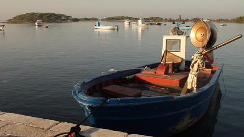 Docked fishing boat with island behind Footage