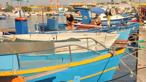 Fishermen working on a boat during fish market Stock Video Footage