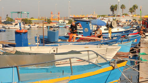 Fishermen working on a boat during fish market Footage
