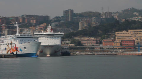 Pan of the port of Genoa, with ferries docked Footage