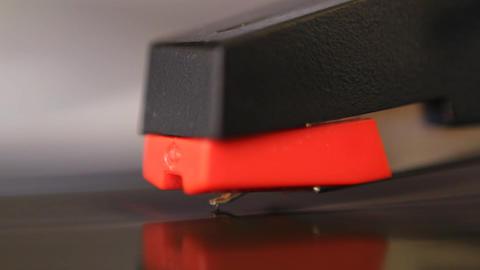 Macro of cartridge and stylus lifting off vinyl Stock Video Footage