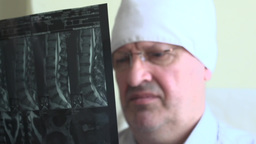 Doctor Examines An X-ray Picture Of The Spine stock footage
