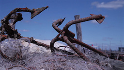 Old rusty fishing boat anchors, slider shot Footage