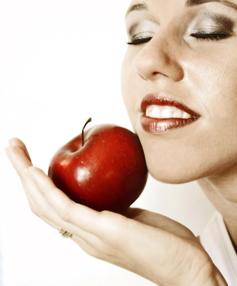 Beautiful woman with red apple isolated on the white background フォト