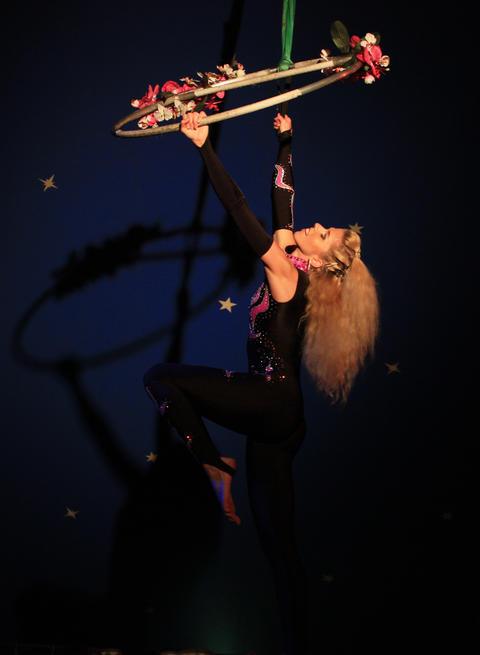 Young woman gymnast at the circus Photo