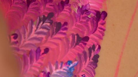 Purple floral design on body GIF
