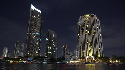business center of a modern city, a metropolis at night. life is boiling. light Footage