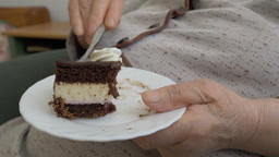 Old lady is eating cake. Closeup on hands and a cake Live Action