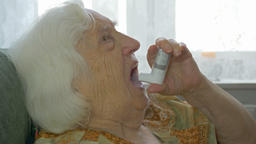 Old lady inhales medicine for asthma Footage