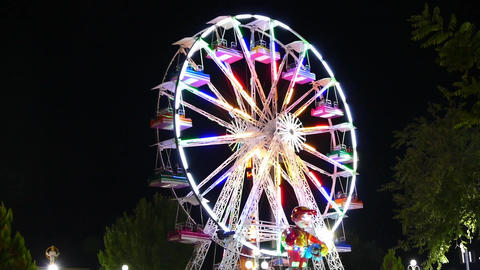 Amusement park and ferris wheel,in the amusement park ferris wheel and colored Live Action