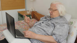 Senior woman disappointed with modern technology. Upset old lady Footage