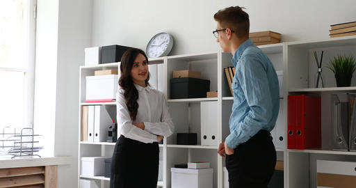 managers communicate standing near cabinet with folders Live Action