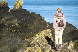 Lady observing the sea at Bull Bay on Anglesey, Wales フォト