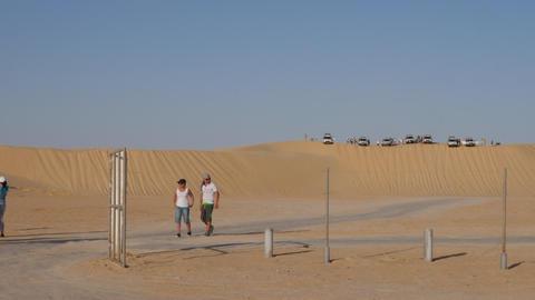 Tunis, Tunisia - 09 June 2018: tourist people on safari trip in sandy desert Live Action