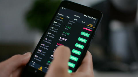 Investor checking Bitcoin, Ethereum and other altcoin cryptocurrency price index Live Action