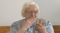 Funny old woman with a smartphone Footage