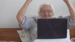Senior woman is gambling online on the internet Live Action