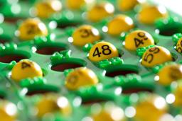 Bingo board half filled with numbers Fotografía