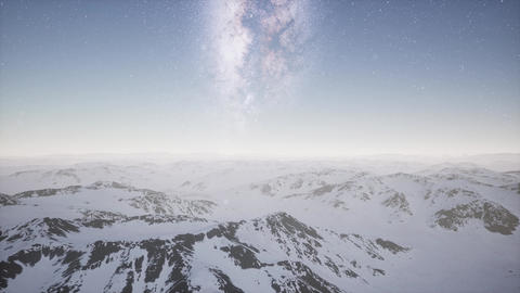 aerial view of Milky Way above snow covered terrain Footage