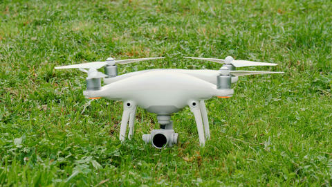 Drone preparing for flight outdoors on grass ビデオ