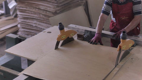 worker prepares the plywood for making furniture in the... Stock Video Footage