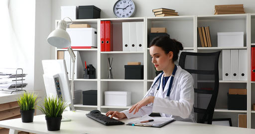 doctors discussing schedules on paper in office Live Action