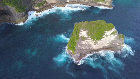 Aerial: Small Rock Island near Nusa Penida - Popular Tourist Destination in Footage
