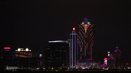 night view looking over the water to the casinos in Macau, China Footage