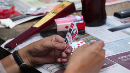 Chinese people play cards in a garden table in macau china Footage