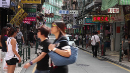 small business street with traffic and people passing by in Macau Footage