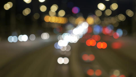 Car traffic at night. lights are blurred out of focus Footage