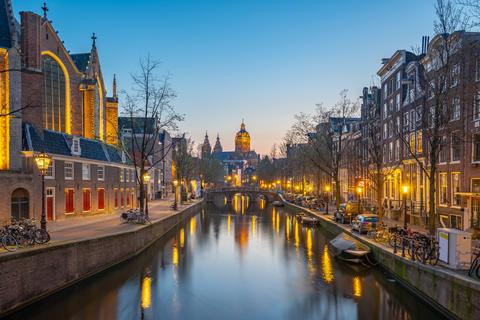 Amsterdam city at night with view of Church of Saint Nicholas Fotografía
