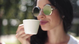Attractive brunette woman drinking coffee Footage