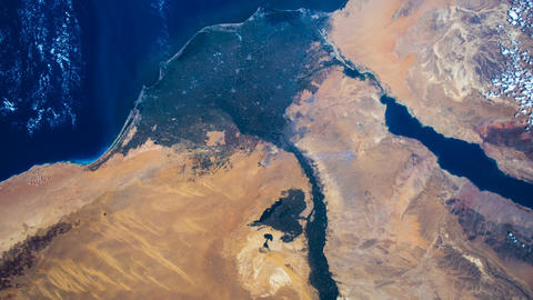 Flying over the earth on the ISS. Flying over desert, aerial view from space Footage
