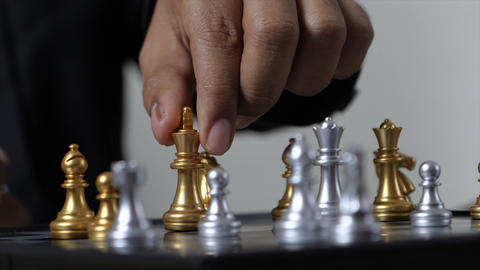 Hand of business man and woman playing chess, select focus shallow depth of field GIF