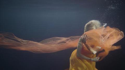 Woman model swimming like mermaid underwater pool on dark background 영상물