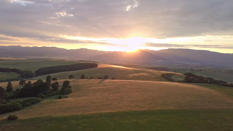 Golden sunset in rural landscape Aerial panoramic view Footage