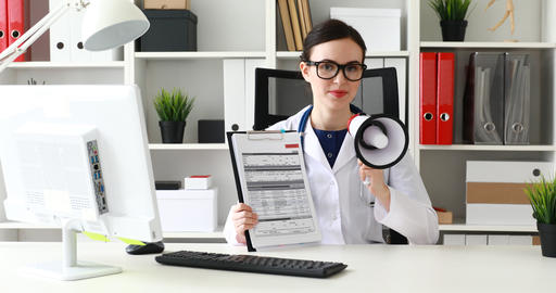 doctor speaking in loudspeaker while in office Live Action