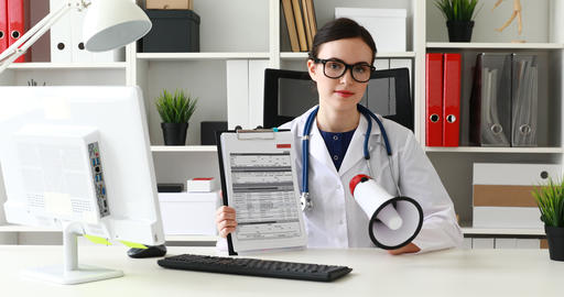 doctor speaking in loudspeaker and showing documents while in office Live Action