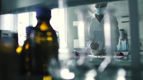 Laboratory assistant prepares the extract in the laboratory Footage