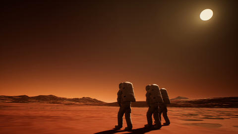 Three astronauts in spacesuits explore the planet Mars Animation
