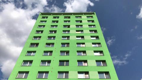 Green prefab flat block under blue sky Footage