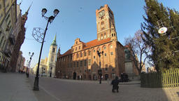 Torun city. Old town. Statue of astronomer Nicolaus Copernicus and the Town Hall Live Action