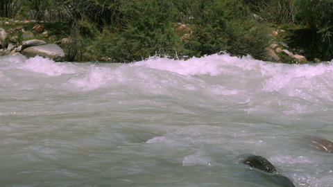 Raging river in wild mountain with boiling water stream. Stormy mountain river Live Action