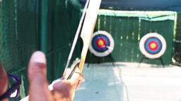Loading, aiming and shooting a bow and arrow at a target. Sport archery. Target Footage