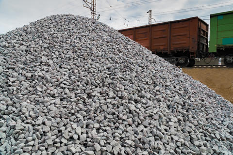Railway. Transportation of crushed stone by rail. Unloading railway platform Photo